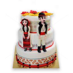 Tort de nunta - port popular. Portul popular traditional romanesc este detaliul de baza al acestui pretios tort de nunta, special creat pentru o petrecere cu aceeasi tematica. Pret: 1920 lei.