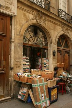 The Abbey, little bookshop in Paris. (ignore graffiti)  The photographer/blogger says that France is a nation of readers.  People are seen reading everywhere--in cafes, parks, on the Metro, waiting for a bus, etc.  (I enjoyed this blog: Paris Through My Lens)