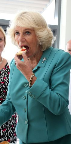 Camilla Parker Bowles Photos Photos - Camilla, Duchess of Cornwall tastes a cake during her tour of the Village Bakery on July 7, 2015  in Wrexham, Wales, United Kingdom. - The Prince of Wales