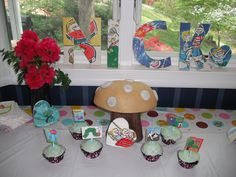 The main table... Mushroom Centerpiece and Children's Book Letters