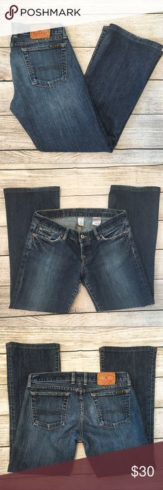 """Lucky Brand Distressed Bootcut Jeans Dark wash distressed Bootcut Jeans from Lucky Brand. Cotton/Lycra. Size 29 (8). Measurements laying flat: Low waist 15"""". Inseam 27.5"""". Front rise 7"""". Rear rise 12.5"""". Lucky Brand Jeans Boot Cut"""