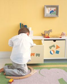 It's difficult to build a train track when you can find only four rails. A compartmentalized toy chest can help. Stencils on the front of each drawer help kids find toys quickly.
