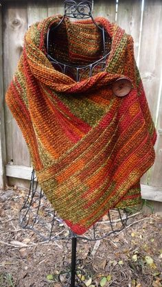 I love ponchos, fall colors, extra chunky wooden button. Masterfully crocheted poncho with large button closure accent - verigated yarn Poncho Au Crochet, Mode Crochet, Knit Or Crochet, Knitted Shawls, Crochet Scarves, Crochet Crafts, Crochet Clothes, Crochet Jacket, Crochet Cowel