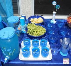 Cute idea for Under the Sea party snack:  Blue jello with gummy sharks on top!