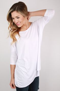 Calling all hard workin' ladies! This top features a high neckline, fitted sleeves and a flowy fit.