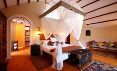 Chuini Zanzibar Beach Lodge is an intimate, boutique hotel, where guests are pampered on a personal level along a perfectly sprawling beach. Zanzibar Hotels, Zanzibar Beaches, Beach Hotels, Hotels And Resorts, Lodges, Room Interior, House Styles, Furniture, African Safari