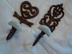 LOT OF 2 STRONG STEEL OR CAST IRON HEARTS BATHROOM KITHEN COAT HOOKS W/ BLUE POT #UNKNOWN
