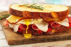 Over easy egg sandwich with smoked gouda, provolone, salami, and roasted red peppers.