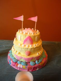 Sandcastle cake for daughter's mermaid birthday party.  Frosting w/ fondant accents and candy shells.