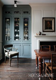 A hutch painted in Farrow Ball's Green Smoke looks polished next to a cream-colored fireplace mantel. Decor, House Design, House, Interior, Home, Living Room Remodel, House Interior, Decorating Advice, Interior Design