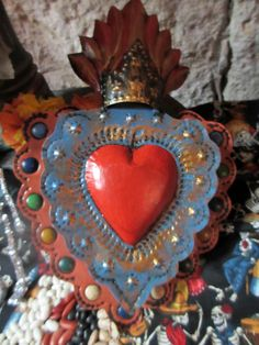 San Miguel de Allende ~ corazon by janelafazio, via Flickr.  La Fuente offers many similar products here: http://www.lafuente.com/Mexican-Art/Tin-and-Glass-Nichos/