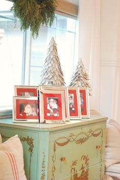 christmas photos framed with red mats