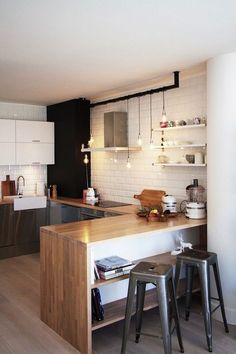 Love all the hanging pendant lighting. Really makes this small kitchen pop.