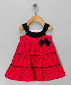 Blossoming with color and boasting a sleeveless silhouette, this soft ruffle-trimmed dress easily slips on for a comfortable and cheerful look. Note: Only infant sizes include diaper covers.