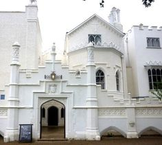 "Front view of the newly restored Strawberry Hill, home of Horace Walpole, by Roger Williams. Walpole's 'little Gothic castle' has significance as one of the most influential individual buildings of such Rococo ""Gothick"" architecture which prefigured the later developments of the 19th century Gothic revival, and for increasing the use of Gothic designs for houses. This style has variously been described as Georgian Gothic, Strawberry Hill Gothic, or Georgian Rococo."