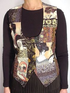 """Geisha Vest  The inspiration for this piece was a Japanese geisha """"portrait"""" print fabric I picked up in New York City's garment district (Robert Kaufman). I was spurred to action by a challenge in the Spring 2003 issue of Quilting Arts magazine. This piece was constructed entirely of fabrics from my stash, with a goal of creating something truly wearable. This is my first attempt at a pieced, quilted, and embellished garment."""
