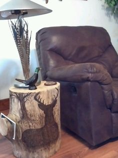 This was my very first piece !!! Pyrography deer stump table with a  magazine holder (:  ♥♥♥KIMSCREATIONS♥♥♥
