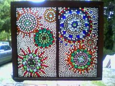 Gorgeous D-I-Y - Glass pebbles glued to an old window, and grout added after plenty of time to dry/set.  Beautiful!