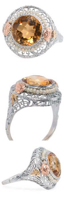 """*Hollywood drama of the 1930s flares its charms with this sexy ring of 14k white gold filigree. Winking its round faceted natural citrine """"eye"""" of an estimated 2.6 carats and with a diameter just shy of 10 mm, this beauty will fit in just about anywhere – but will not do it quietly. Circa 1930."""