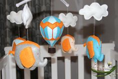 With MUSICAL CRIB ATTACHMENT. Turquoise blue and grey, flying elephants and hot air balloons babies musical rotating mobile. Ready to ship