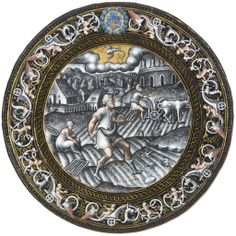 A CIRCULAR PARCEL-GILT GRISAILLE ENAMEL PLATE REPRESENTING THE MONTH OF SEPTEMBER -  WORKSHOP OF PIERRE REYMOND, CIRCA 1570-1580