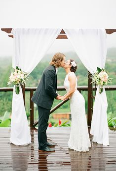 Brides.com: 73 Amazing Ceremony Structures A rustic wooden arbor, crawling with natural greenery, gets glam with a hanging chandelier.Photo: Michelle March Photography
