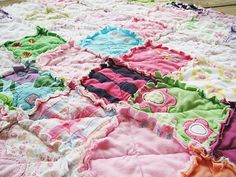 Memory Rag Quilts made from baby clothing... love the edges of the squares!