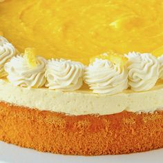 An easy version of lemon mousse comprised of lemon curd and whipped cream sits atop a light-as-air sponge cake and is then topped with more lemon curd, whipped cream and candied lemon peel. Spring Desserts, Lemon Desserts, Vanilla Whipped Cream, Vanilla Cake, Lemon Mousse Cake, Candied Lemon Peel, Lemon Curd Recipe, Cake Toppings, Sponge Cake