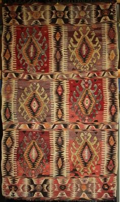 Dramatic large old Anatolian yoruk kilim from Mut. Great colour contrast and abrash and wonderful dynamic drawing of motifs bring the kilim ...