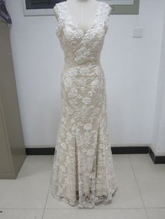 Champagne V neck sheath lace wedding dress chapel train zipper back. $199.00, via Etsy.