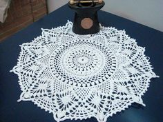 The pattern is rated intermediate. The pattern specifies Bedspread Weight Cotton Thread (size 10): 225 yards (205.5 meters). The doily is worked in 29 rounds.