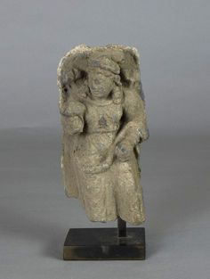 Object 2012.1.7 Attendant female figure with flower. Old = valuable?. Maybe Abby can provide more context about its significance or lack thereof?