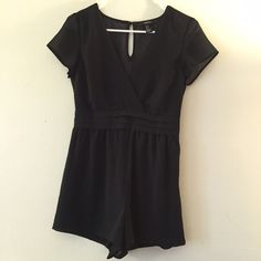 Forever 21 Vneck romper Sexy short vneck romper with side zip closure. I LOVE this romper because it doesn't bunch at the hips or look awkward at the thighs! The vneck is so tasteful and I've gotten so many compliments on this item! Forever 21 Dresses Mini
