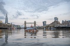 A floating mock-up of a typical British suburban home was seen slowly sinking into the Thames in central London on Sunday in a protest organized by Extinction Rebellion to demand politicians fighting a Dec. 12 general election act on climate change. Palais De Buckingham, London Protest, London Metropolitan, Environment Agency, Tower Bridge London, Suburban House, Sea Level Rise, Down The River, The Daily Show