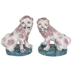 Pair of 18th Century Brussels Faience Lions | From a unique collection of antique and modern sculptures at https://www.1stdibs.com/furniture/decorative-objects/sculptures/