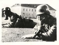1942- Gas-masked German soldiers practicing for chemical warfare during training in Berlin.