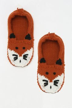 Animal Slipper-Sock -- for long, over-sees trips.  You seriously need to take your shoes off and wear some warm socks. Comfort level goes through the roof.