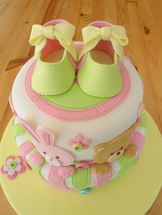 Love the stitching detail on the booties and fondant. Another adorable baby shower cake & Spring time