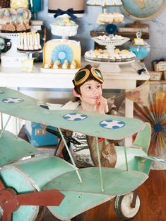 Hostess with the Mostess®Pairing Harry's favorites: yellow and airplanes, Kiss My Cakes, whipped up a Vintage Airplane Party for the special birthday boy! Read Helen's details to learn about Harry and all of the wonderful touches that went into this soaring celebration! And for more airplane party i