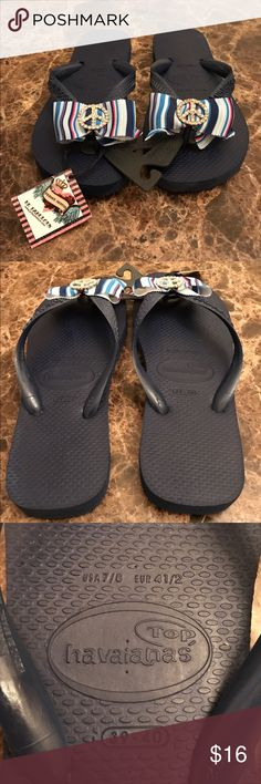 NWT HAVAIANAS FLIP FLOPS NWT HAVAIANAS BLUE FLIP FLOPS. BOW N JEWELED PEACE SIGN. These fit a 7/8. See pic Havaianas Shoes