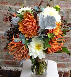 November bouquet with local dahlias, dusty miller, eucalyptus, broom corn, pine cones and magnolia.