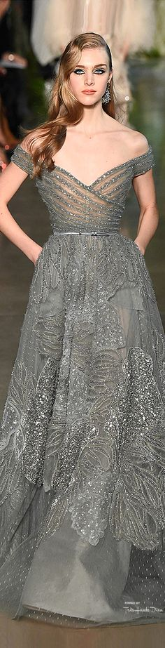 Elie Saab Spring 2015 Couture. This silver, subtly patterned and glittered gown truly is a beauty.