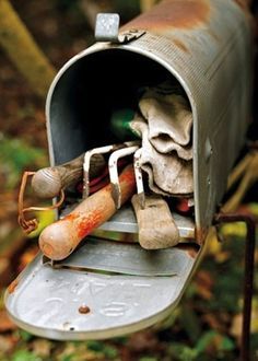 Repurpose an old mailbox to hold garden tools in the backyard. | 51 Insanely Easy Ways To Transform Your Everyday Things