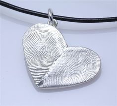 yours and your love's thumb-prints on a heart pendant <3
