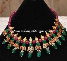 Gold and Diamond jewellery designs: ruby emerald designer necklace