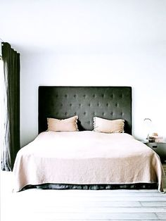 tall tufted head board creates drama