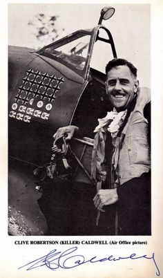 """Signed official portrait of G/Cpt Clive """"Killer"""" Caldwell, DSO, DFC and Bar. The picture has been taken at at Morotai in 1945, when Caldwell was commanding No. 80 (Fighter) Wing RAAF. His personal aircraft shown here is the Supermarine Spitfire Mk. VIII numbered A58-484 maintained by No. 452 Squadron. The scoreboard in front of the windscreen depicts his 27,5 victories against German, Italian and Japanese aircraft which made Caldwell the top Australian ace of the war. [Air Office photo…"""