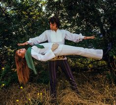 "Jim Morrison of The Doors ""levitating"" his girlfriend, Pamela Courson, in 1968."