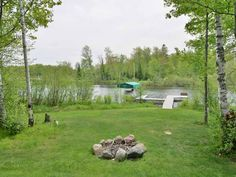 Vacation in Northwoods executive style and comfort at Cajun's Cove a beautiful vacation home rental on Lake Namakagon in Cable, Wisconsin only 20 miles from Hayward, WI. Vacation Home Rentals, Bedroom Loft, Full Bath, Square Feet, Exterior, Plants, Beautiful, Bathroom, Planters
