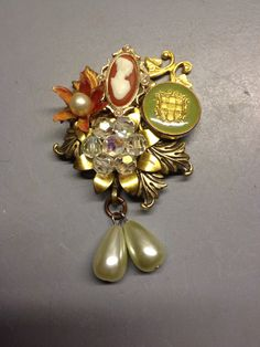 Brooch made of an old medal, earring and button